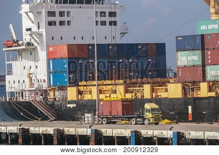 Labuan,Malaysia-Aug 2,2017:Shipping containers loading & unloading of containers crane truck at Labuan port,Malaysia.The abolishment of cabotage policy is set to benefit this duty free island economically.