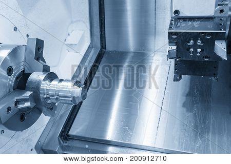 CNC lathe machine (Turning machine) cutting the metal cone shape part .Hi-precision CNC machining concept.