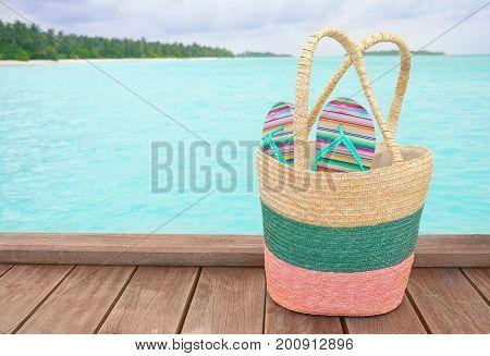 Beach accessories on wooden pontoon at sea resort