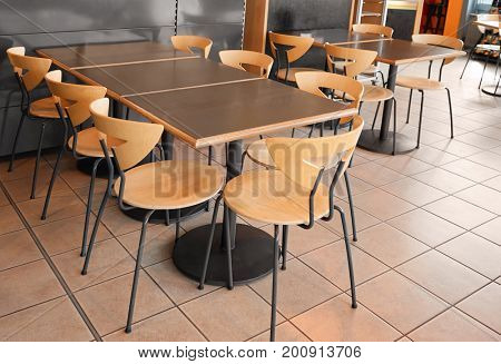 Modern cafeteria with tables and chairs