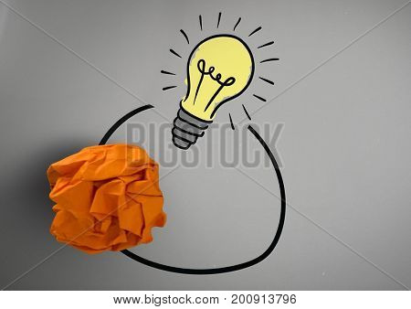 Digital composite of light bulb with crumpled paper ball
