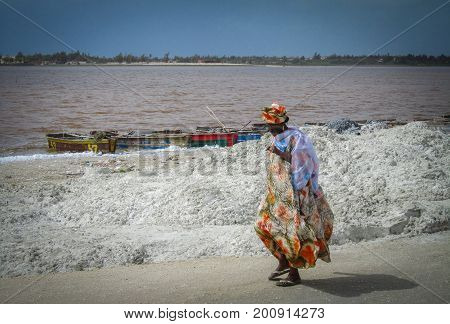 Dakar, Senegal - May 28, 2011 - A woman walks the shore of Lac Retba, also known as the pink lake