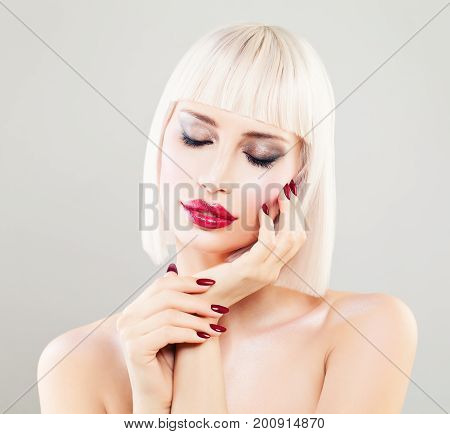 Perfect Blonde Woman Fashion Model. Cute Girl with Blonde Bob Hairstyle Makeup and Manicure