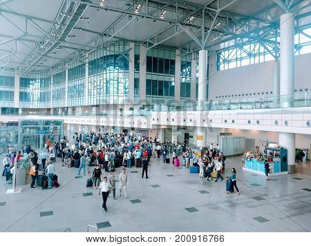 MOSCOW, RUSSIA - AUGUST 05, 2017: People in the departure terminal of Domodedovo International Airport. It is the second largest Russian airport by passenger traffic