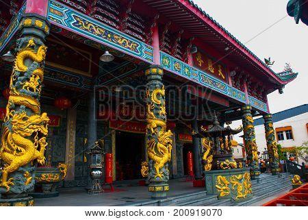 Golden Dragon On The Pole. Tua Pek Kong Chinese Temple. Bintulu City, Borneo, Sarawak, Malaysia