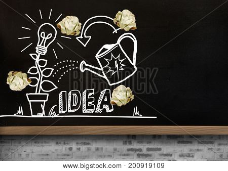 Digital composite of light bulb and ideas drawings garden with crumpled paper balls  in front of blackboard