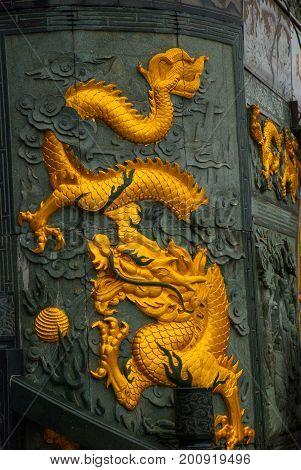 Golden Dragon Frieze Tua Pek Kong Chinese Temple. Bintulu City, Borneo, Sarawak, Malaysia