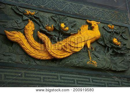 Golden Frieze The Peacock. Tua Pek Kong Chinese Temple. Bintulu City, Borneo, Sarawak, Malaysia