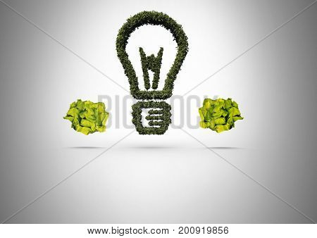 Digital composite of green nature light bulb with crumpled paper balls