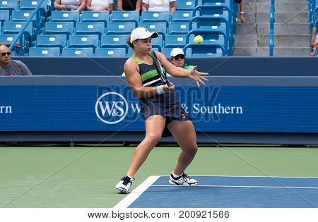 Mason Ohio - August 16 2017: Ashleigh Barty in a second round match at the Western and Southern Open tennis tournament in Mason Ohio on August 16 2017.