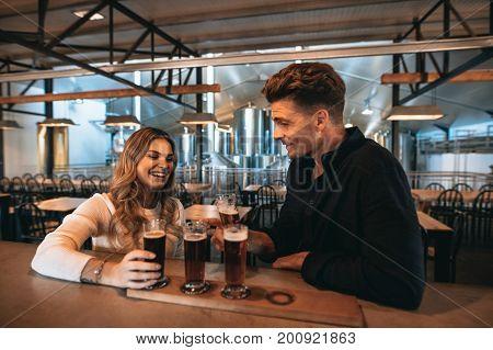 Brewery Owners Tasting Varieties Of Beers At The Bar