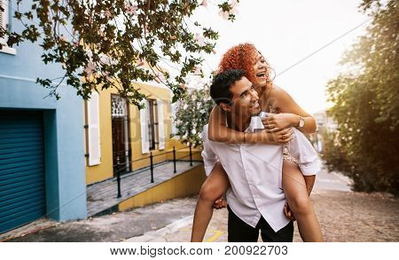 Young Couple In A Playful Having Fun In The Street.