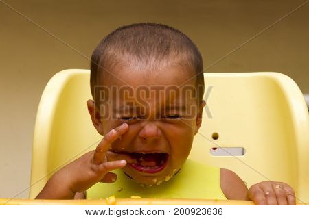 Baby Boy Crying While Eating