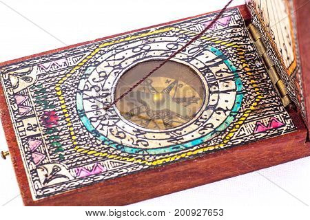 Early 18th Century Compass in Wooden Box on White Background. Replica