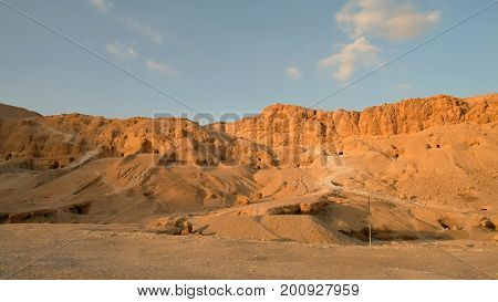Excavations of ancient tombs in the orange sand hills without people, Luxor, Thebes, UNESCO World Heritage Site, Egypt, North Africa, Africa