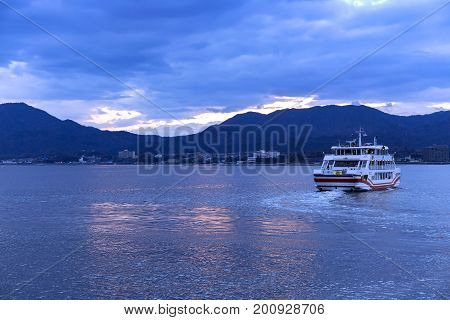JAPAN, MIYAJIMA, APRIL, 06, 2017 - Ferry crossing between Miyajima Island and the city of Hatsukaichi in Hiroshima Prefecture in Japan.