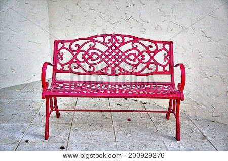 Red Bench In A White Courtyard
