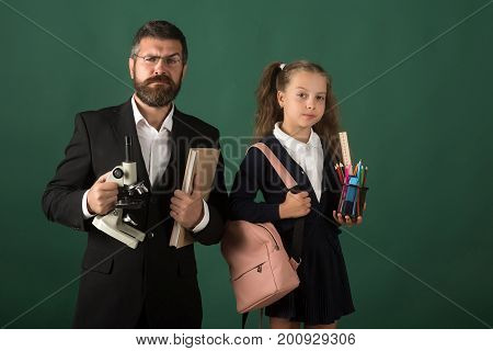 Education And Back To School Concept. Kid And Tutor