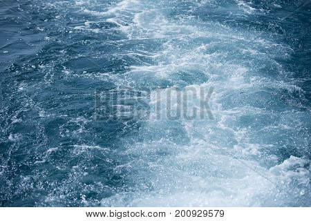 Abstract marine background. Sea or ocean blue water. Seascape natural water wallpaper. Travel vacation and sea voyage concept.