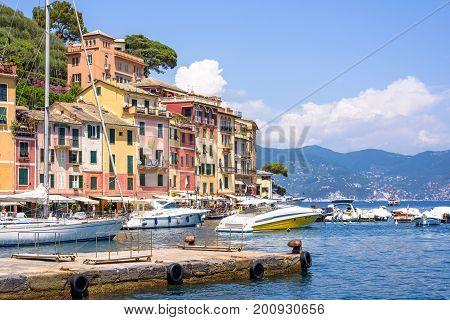 PORTOFINO, ITALY - JUNE 26, 2017: Beautiful daylight view to Portofino streets and ships on water. Italy beauties.