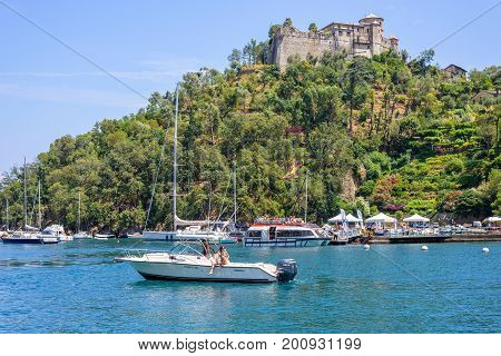 PORTOFINO, ITALY - JUNE 26, 2017: Daylight view to ships cruising on water near Portofino city in Italy