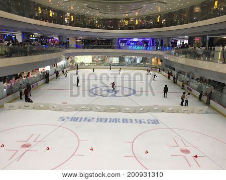 Wuhan, China, 4 February 2017: Ice skating rink with chinese people in a luxury shopping mall