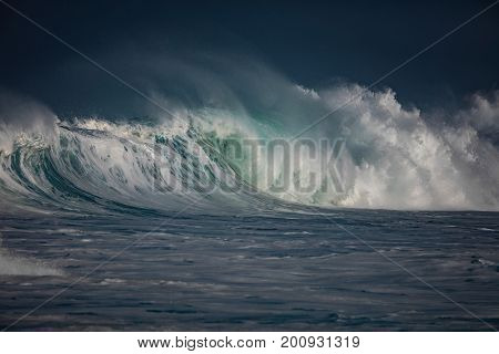 Huge waves crashing in storming ocean. Seascape rough environment background. Water texture with foam and splashes. Hawaiian surfing spot with nobody