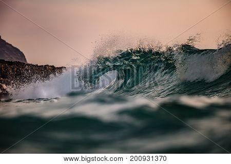 Vibrant ocean wave barreled. Closeup image shot from water