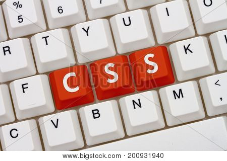 Designing websites using CSS code A close-up of a keyboard with orange highlighted text CSS 3D Illustration