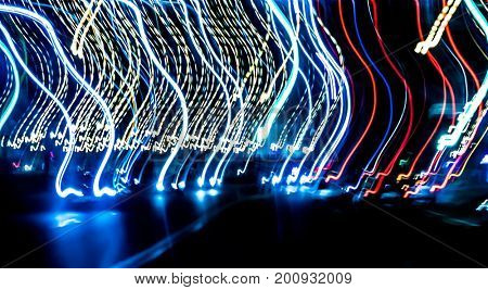 Abstract colurful lights, cars and road at night