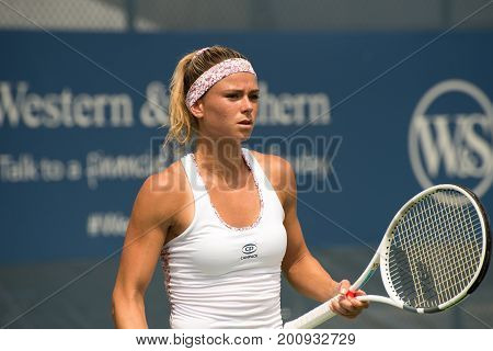 Mason Ohio - August 14 2017: Camila Giorgi in a first round match at the Western and Southern Open tennis tournament in Mason Ohio on August 14 2017.