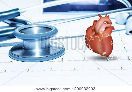 stethoscope and heart on ekg graph sheet