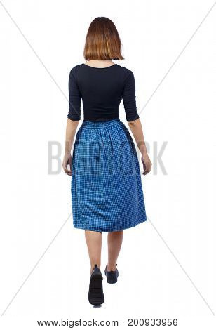 back view of walking woman in dress.   beautiful girl in motion.  backside view of person.  Rear view people collection. Isolated over white background. The girl in the blue plaid skirt moves forward