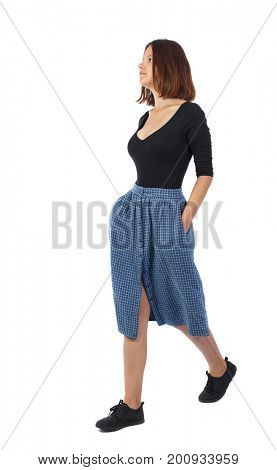front view of walking  woman. beautiful girl in motion.  backside view of person.  Rear view people collection. Isolated over white background. The girl in the blue checkered passes by. side view.