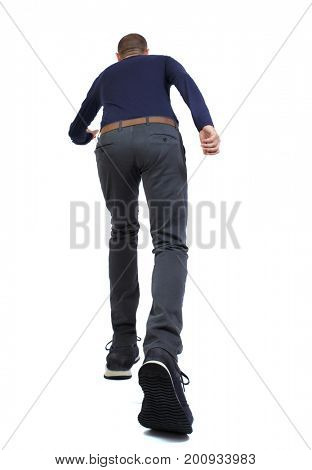 Back view of running handsome man. walking young guy . Rear view people collection.  backside view of person.  Isolated over white background. Wide-angle shot of a running man in pants and sneakers