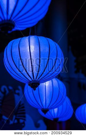 Colorful blue Chinese lanterns in the Tivoli park Copenhagen.