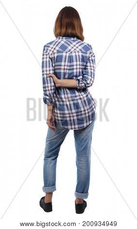 back view of standing young beautiful  woman.  girl  watching. Rear view people collection.  backside view of person. A girl in a plaid shirt shows a sign of a party....