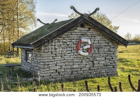 Picture of Stone house with life buoy