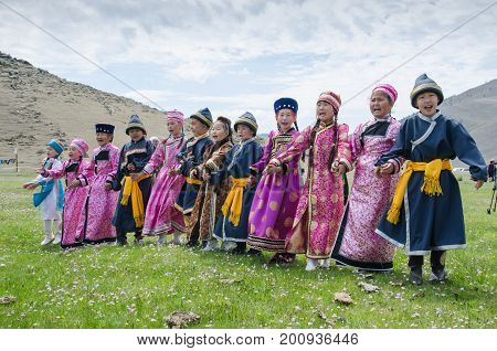 Bayanday, RUSSIA - JUNE 14: yordinskiye games, Buryat children in national costumes sing songs under the sky in yordynskyh games, June 14, 2015 in Bayanday, Irkutskiy region, Russia.