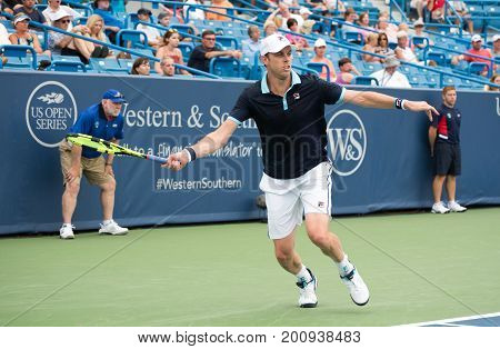 Mason Ohio - August 14 2017: Sam Querrey in a first round match at the Western and Southern Open tennis tournament in Mason Ohio on August 14 2017.