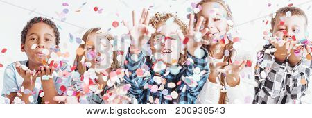 Group Of Children Throwing Confetti