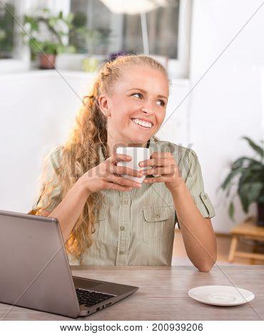 Woman Having Break From Work In Office