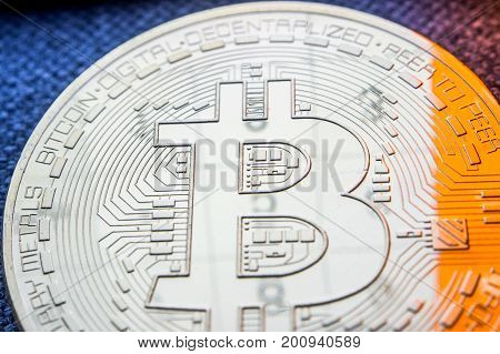 Golden Bitcoin Coin With A Numbers Reflection On Its Surface