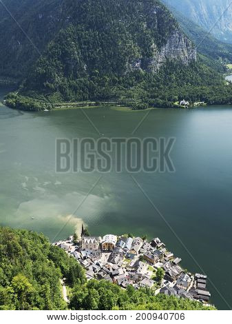 Hallstatt landscape, Salzburg. Mountain lake, Alpine massif, beautiful canyon in Austria. Alpine valley in summer clear water. Healthy virgin mountain nature, vacation destination, bird perspective.