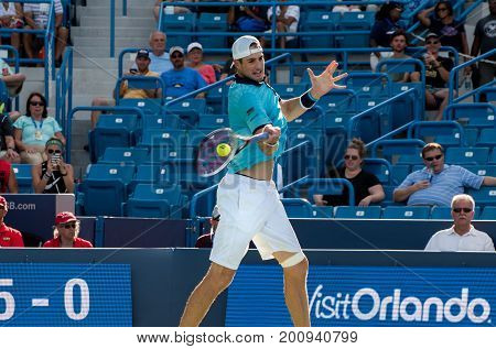 Mason Ohio - August 18 2017: John Isner in a round of 16 match the Western and Southern Open tennis tournament in Mason Ohio on August 18 2017.