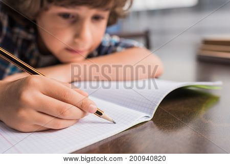 Kid Writing In Copybook