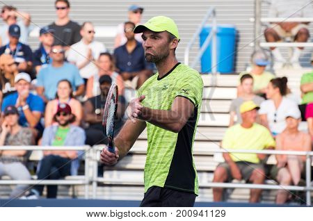 Mason Ohio - August 15 2017: Ivo Karlovic in a second round match at the Western and Southern Open tennis tournament in Mason Ohio on August 15 2017.