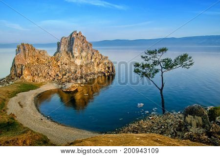 Summer sunset over Mountain Rock of Shamanka Burhan on Olkhon Island in Lake Baikal Russia