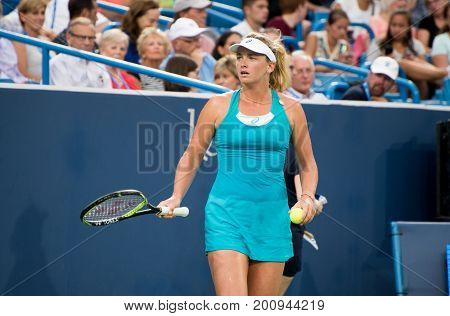 Mason Ohio - August 14 2017: CoCo Vandeweghe in a first round match at the Western and Southern Open tennis tournament in Mason Ohio on August 14 2017.