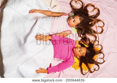 Kids In Pink Pajamas Covered With White Blanket